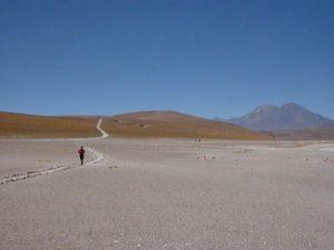 A lone runner in the desert